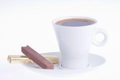 咖啡用在茶碟的巧克力 免版税库存照片