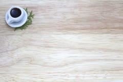 咖啡的图片有木背景 免版税图库摄影
