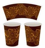 咖啡的装饰纸杯 库存图片