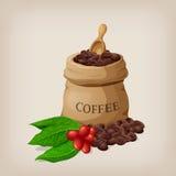 咖啡袋用在帆布大袋的豆和咖啡分支与叶子 免版税库存图片