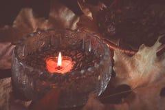 咖啡豆和蜡烛 库存图片