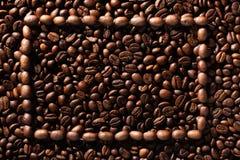 咖啡豆框架在咖啡豆的 库存图片