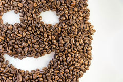 咖啡豆面带笑容面孔 库存照片