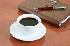 咖啡附注笔 免版税库存照片