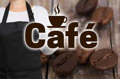 咖啡馆概念由咖啡烘烤器显示 免版税图库摄影