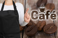 咖啡馆概念由咖啡烘烤器显示 免版税库存照片