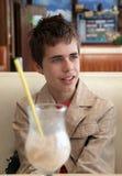 咖啡馆的少年 库存照片