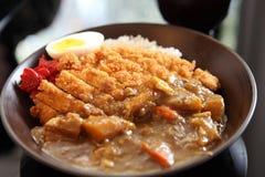 咖喱米用油煎的猪肉 免版税库存图片