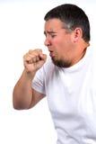 咳嗽在拳头的人 免版税库存图片