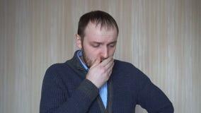 咳嗽由墙壁的英俊的有胡子的人 股票录像