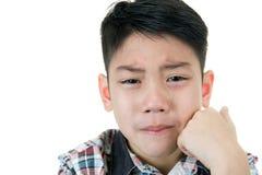 哀伤亚裔逗人喜爱的男孩和哭泣 库存照片