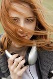 哀伤女孩的耳机 图库摄影