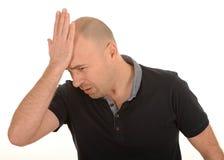 哀伤的人用在头的手 库存图片