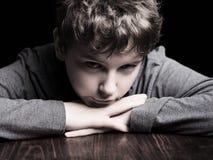 哀伤的十几岁的男孩 免版税图库摄影