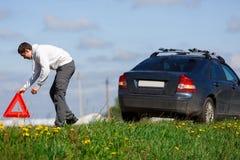 哀伤的司机投入红色标志 图库摄影