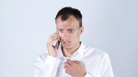 哀伤的商人谈话在手机 免版税库存图片
