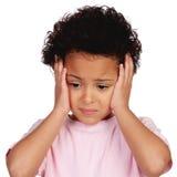 哀伤的小女孩以头痛 免版税图库摄影