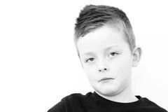 哀伤的小男孩 免版税库存照片