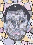 哀伤的石面孔 免版税图库摄影