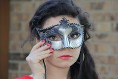 哀伤的青少年的化妆舞会面具 库存照片