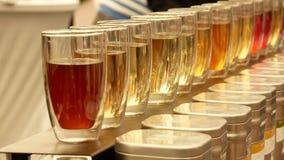 品尝茶 有茶和成份不同形式的玻璃杯子  影视素材