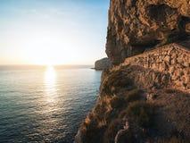 品柱卡奇亚峭壁在阿尔盖罗,撒丁岛,意大利附近的 免版税图库摄影