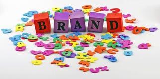品牌在字上写字 库存照片