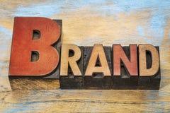 品牌在活版木头类型的词摘要 免版税图库摄影