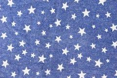 织品牛仔裤样式有星背景 免版税图库摄影