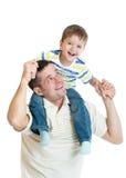 哄骗儿子骑马在白色隔绝的爸爸的肩膀 免版税库存照片