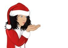 哇!服装圣诞老人吹的雪花的愉快的女孩 图库摄影