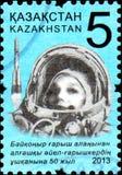 哈萨克斯坦-大约2013年:在哈萨克斯坦打印的邮票致力了飞行的第50周年入空间第一名妇女- cosmo 免版税库存图片