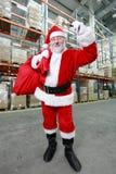 响铃克劳斯红色敲响的大袋圣诞老人 库存照片