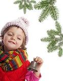 响铃圣诞节女孩少许云杉的结构树 免版税库存照片