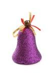 响铃圣诞节装饰查出的紫色 免版税库存照片