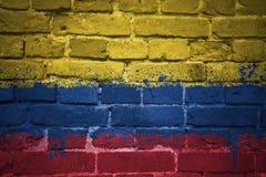 哥伦比亚的被绘的国旗在砖墙上的 库存照片