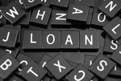 哥特式黑体字铺磁砖拼写词& x22; loan& x22; 免版税库存图片