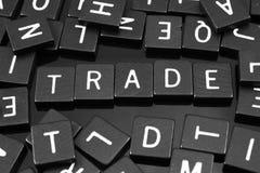 哥特式黑体字铺磁砖拼写词& x22; trade& x22; 库存图片