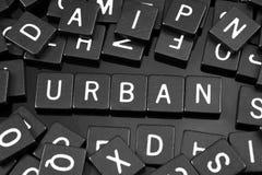 哥特式黑体字铺磁砖拼写词& x22; urban& x22; 库存图片