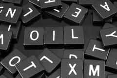 哥特式黑体字铺磁砖拼写词& x22; oil& x22; 免版税库存照片