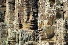吴哥窟Bayon在早晨太阳光的石头sculpcute 免版税图库摄影