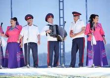 哥萨克唱诗班的表现在三位一体节日的 免版税库存照片