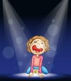 哭泣在阶段的男孩 免版税库存图片