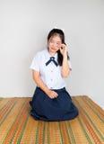 哭泣的亚裔泰国高中学生 库存图片