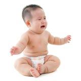 哭泣的亚洲男婴要求食物 图库摄影