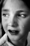 哭泣的女孩少许泪花 免版税库存照片