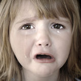 哭泣的女孩少许泪花 库存图片