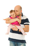 哭泣的婴孩亲吻人 库存图片