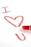 唇膏书面的爱红色 库存图片