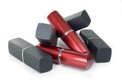 唇膏红色和黑管  免版税库存图片